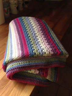 Granny stripes blanket with mixed crochet patterns. ! Looks complicated, but love the colors.