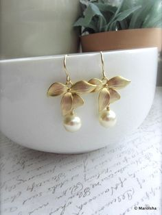 Orchid Flower Ivory Pearl Drop Dangle Earrings. Bridesmaid Gifts. Maid of Honor. Garden Cottage Wedding. Ivory Wedding. Vintage Style, via Etsy.