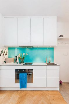 white kitchen, clean turquoise backsplash
