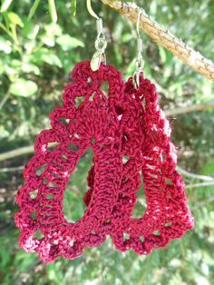 These burgundy red tear-drop shaped crochet earrings are super cute and sure to make a statement! They have wire hooks and are about 3 1/2 inches long.