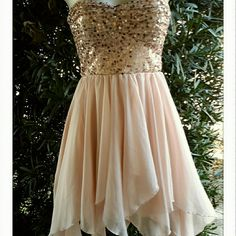 Euc Gorgeous formal/prom dress Stunning soft pink with champagne sequence. Worn once that's it. No flaws at all. The bottom has a scalloped look. Has been kept in a dress bag no stains but because it has been worn mabey a dry clean will do. Comes from a smoke and pet free home Bundles always welcome  Price negotiable No rude comments or you will be blocked Reasonable offers only delias  Dresses Strapless