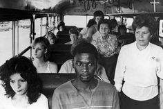 A man rides a bus in Durban, meant for white passengers only, in resistance to South Africa's apartheid policies 1986