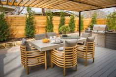 """""""One of the wonderful spaces in this house is the pergola-covered deck with an amazing dining area,"""" says HGTV Smart Home 2015 designer Linda Woodrum, who feels the back deck will allow homeowners to take advantage of warm Austin nights. Deck With Pergola, Covered Pergola, Diy Pergola, Covered Porches, Wood Pergola, Outdoor Rooms, Outdoor Dining, Outdoor Furniture Sets, Outdoor Decor"""