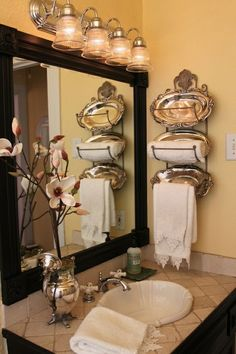 Towel rack, love the silver-plate dishes