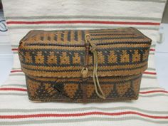 """Antique Cherokee Basket with attached lid early 1900's been told by an authority that this is a Cherokee Basket from  the 1910 - '20's.  It has issues- breaks and wear.  The basket measures approximately 12"""" longs,  6"""" high and 6"""" wide. SOLD $41.00"""