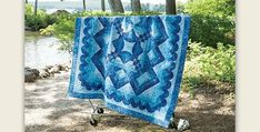Showcase Your Quilt Making Skills! Beautiful blues combine in a gorgeous and impressive medallion quilt. The monochromatic color scheme is simply stunning and will be just as beautiful in your favorite color. We can easily imagine it in black, grays and tans, and in muted purples. While we love the blue on blue, the intriguing …