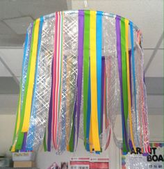 Hula hoop with ribbon. Hang in cozy area, drama or above table.