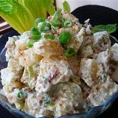 Beaumont Ranch Potato Salad | The potatoes are seasoned with a garlicky salad dressing while still hot, then cooled and mixed with bacon, celery, green onion, dill pickle, and mayonnaise.