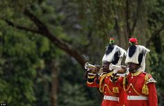 Members of a Kenyan military band sound bugles to mark the start of two minutes' silence on Remembrance Sunday at the Nairobi War Cemetery in Kenya