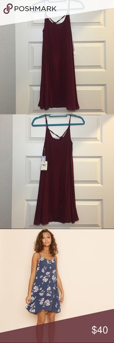 Garage burgundy slip crinkle dress New with tags! Garage rock burgundy slip crinkle dress from Canada. This is a beautiful dress and very flattering! The model is wearing the same exact style of dress but in a different pattern. Size small. Please use the offer tool for offers and not in the comments. I'm not interested in trading. Garage Dresses Midi