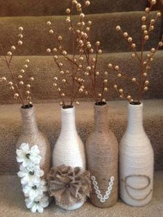 'Love' wine bottle set. Twine and yarn wrapped wine bottles for a great rustic set. Wine bottle craft. DIY by KAOUTER