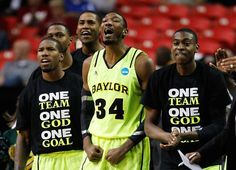 """One Team, One God, One Goal"" printed on men's basketball team t-shirts."