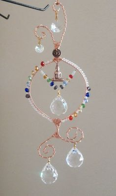 Crystal Chakra Suncatcher with Buddha, Om,Made to order, multi Prims, Feng Shui… Feng Shui Crystals, Chakra Crystals, Crystals And Gemstones, Crystal Beads, Faceted Crystal, Mobiles, Wire Crafts, Bead Crafts, Suncatchers