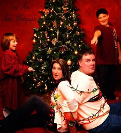 Funny Christmas Photography - Hilarious! Madison can be sitting off to the side holding a string of lights and we can be tied up