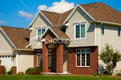 Google Image Result for http://i.istockimg.com/file_thumbview_approve/13733446/2/stock-photo-13733446-red-brick-house-with-architectural-asphalt-roof-vinyl-siding.jpg