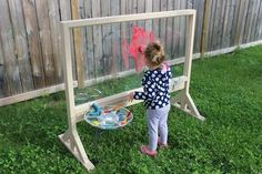 Build a DIY acrylic painting easel and watch your budding artists at work! Kids Outdoor Play, Kids Play Area, Outdoor Learning, Backyard For Kids, Toddler Easel, Outdoor Projects, Diy Projects, Diy Easel, Sensory Garden