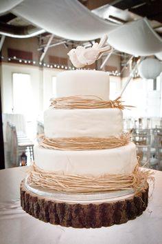 Rustic Wedding Cake. I like the raffia as a border, very simple