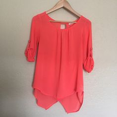 Coral Quarter sleeve blouse Semi-sheer and to be worn with a tank top underneath, just a nude bra may be fine too. Only been worn a few times, in excellent condition. Active Tops Blouses