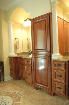 Beautiful Sink & Cabinets Lined With White Pillars - plan 076D-0204 | houseplansandmore.com  #home #bath #sink