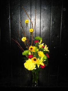 bright and sunny vased arrangement