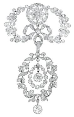 Belle Époque Platinum and Diamond Brooch, Cartier. Topped by a circle centring a flower, flanked by a garland of florets and leaves, centring a bow, joined by an oval link supporting an oval garland of florets, leaves and ribbons, centring a flexibly-set old European-cut Diamond within a drop-shaped outline of collet-set Diamonds, suspending a collet-set Diamond, set throughout with numerous small old European-cut Diamonds, signed Cartier, circa 1905.