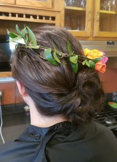 A spring wedding updo with flower crown for the bridesmaid. By Shana Montgomery owner of Fringe Theory Salon.