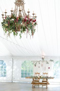 Chandelier in tented wedding reception with green and maroon floral arrangements Whimsical Wedding Theme, Boho Wedding, Wedding Reception Decorations, Table Decorations, Floral Chandelier, Marry Me, Decor Styles, Floral Arrangements, Death