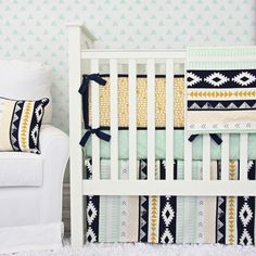 Aztec nursery design is a huge trend for 2015! Our aztec baby bedding is gorgeous with a gold, navy, and arrow combination.
