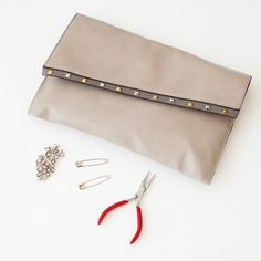 How to Make a DIY Leather Studded Clutch | Brit + Co.
