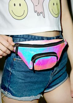 Skinnydip Cosmo Fanny Pack is perfect fer stashin' yer sh!t during an interstellar expedition! This sikk fanny pack features a crazy bright textured holographic construction that shines hues of pinks, purples, and blues, small front pouch, top zip closure, and adjustable black utility clip belt.