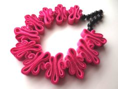 Handmade item.  Made in USA.100%  Felt recycled from plastic bottles.  Eco friendly necklace.  Its a collar boho necklace.  In pink colours, also