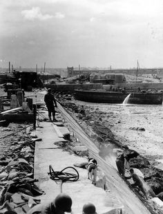 Sappers American 333rd Engineer Special Service Regiment working in the port of Cherbourg and repair the platform of the Darse honeys, July 13, 1944.