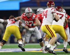 Dec 29, 2017; Arlington, TX, USA; Ohio State Buckeyes defensive end Nick Bosa (97) applies pressure in the second quarter against Southern California Trojans quarterback Sam Darnold (12) in the 2017 Cotton Bowl at AT&T Stadium. Mandatory Credit: Matthew Emmons-USA TODAY Sports