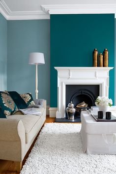 """Period rooms don't need to be painted with """"traditional"""" colours. So forget whites and creams and try more distinctive colours. High ceilings can carry modern, bold colours. Accessories can really complete the look, copper vases set this room off beautifully. Colours: Stepping Stone, Royal Ocean."""