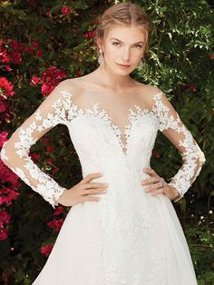 Mysterious Wisteria features an elaborate lace pattern that covers the illusion bateau neckline and short sleeves, which encases a plunging V-shaped neckline. ...