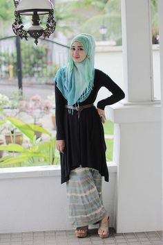 Grey printed skirt, black shirt, blue/green scarf, wedges, silver/black ring