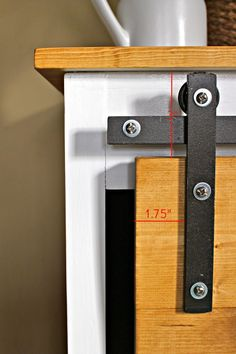 How to make your own sliding barn door console hardware using off the shelf supplies from the hardware store. DIY hardware for your sliding barn doors. - July 06 2019 at Decor, Diy Sliding Door, Making Barn Doors, Sliding Doors, Furniture Projects, Diy Furniture, Bottle Opener Wall, Doors, Barn Door Console