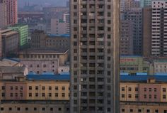 An apartment block stands among the buildings in central Pyongyang at dusk on April 10, 2013. (David Guttenfelder / AP)