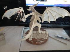 Alana used Plastimake to create the wing membranes and other details for this amazing dragon sculpture. Plastic Items, Biodegradable Products, Sculpting, Sculptures, Wings, Dragon, Diy Projects, Create, Amazing