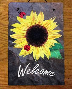 Hand painted slate, sunflower welcome sign. 8''x 12''. $45. Could do with name or numbers. Can do customization; also does horizontal slate markers.