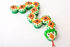 Snake Birthday Cake in Cupcakes: For a twist on the traditional birthday cake, try creating a slithery, tasty treat out of cupcakes, instead.