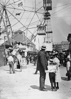 Endless entertainment: A young boy and girl stand with a man looking in the direction  cam...