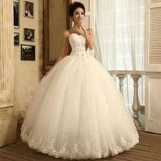 [The bodice comes up too high for this model, but it's an interesting gown and I like the skirt.]