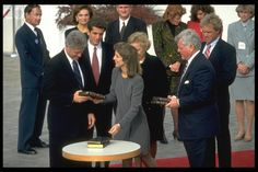 OPENING OF 'J.F.K.' LIBRARY IN BOSTON Original caption: Caroline Kennedy gives President Bill Clinton some books.   October 29, 1993
