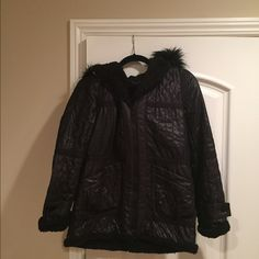 BCBG coat BCBG very warm coat. Front pockets with the hoodie. Wore it 2 times. Very warm and comfortable. It's XXS but it runs big I would size it's a regular Small. Good condition BCBG Jackets & Coats Pea Coats