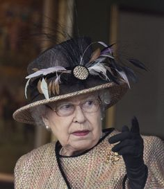 Queen Elizabeth II attends The Dubai Duty Free Raceday where she watched her horse 'Sign Manual' win Race 5.