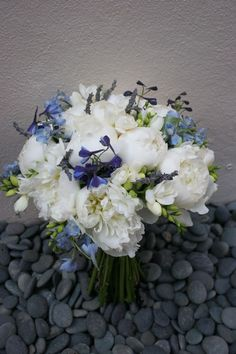 Blue delphinium, freesia and white peony bouquet