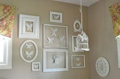 Book page butterflies displayed in empty frames (and on an empty birdcage).