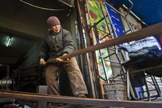 Liu Shujian, a 90-year-old lady, continues her electro welding work at Wanshousi Street on Dec. 5, 2014 in Shenyang, Liaoning province of China. (ChinaFotoPress/Getty Images)