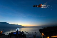 Santa Claus waves to the crowd from his flying sleigh drawn by reindeer over the Geneva Lake on the first day of the edition of the Christmas Market in Montreux, Switzerland. Switzerland Christmas, Lake Geneva, World Images, World Records, Pictures Images, Christmas Pictures, Travel Inspiration, Places To Go, Surfing
